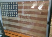 Flag made by Frenchwoman from scraps of German flags. She wanted to have an American Flag ready for when the Allies arrived.